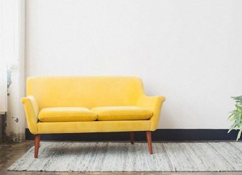 6 Inspiring Ideas For Using Primrose Yellow In Your Home Decor - Image Of Primrose Yellow Couch By papernstitchblog.com