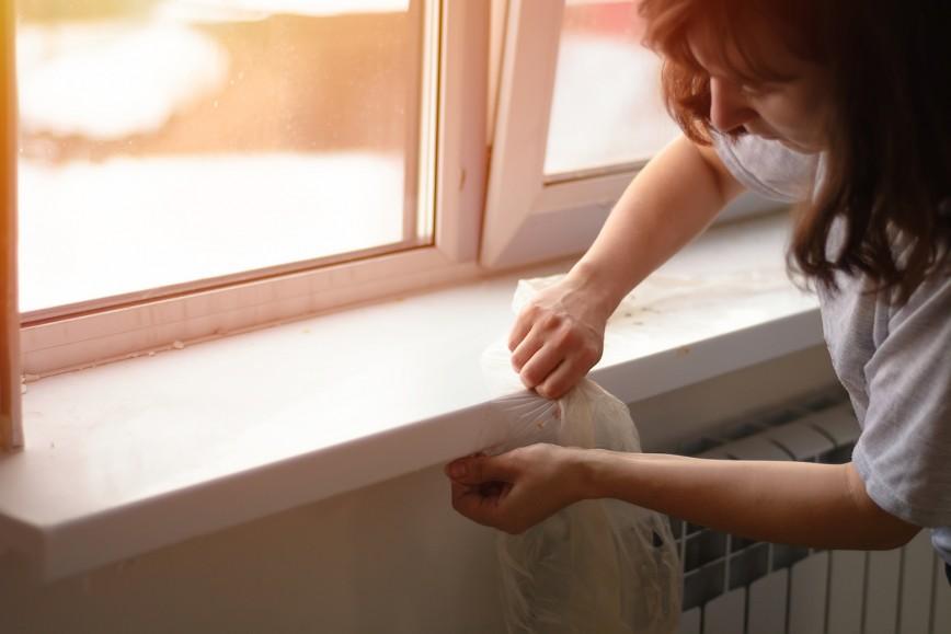 Women replacing window sill