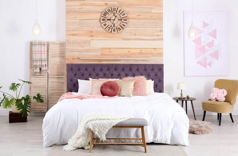 Bedroom with purple headboard