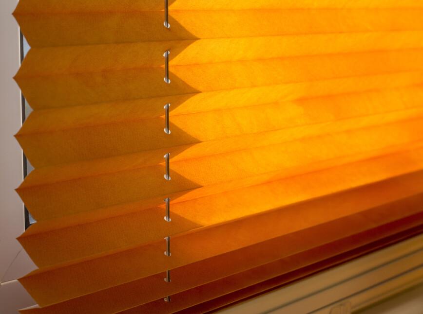 Orange pleated blinds