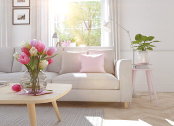 Cream sofa. Vase with tulips