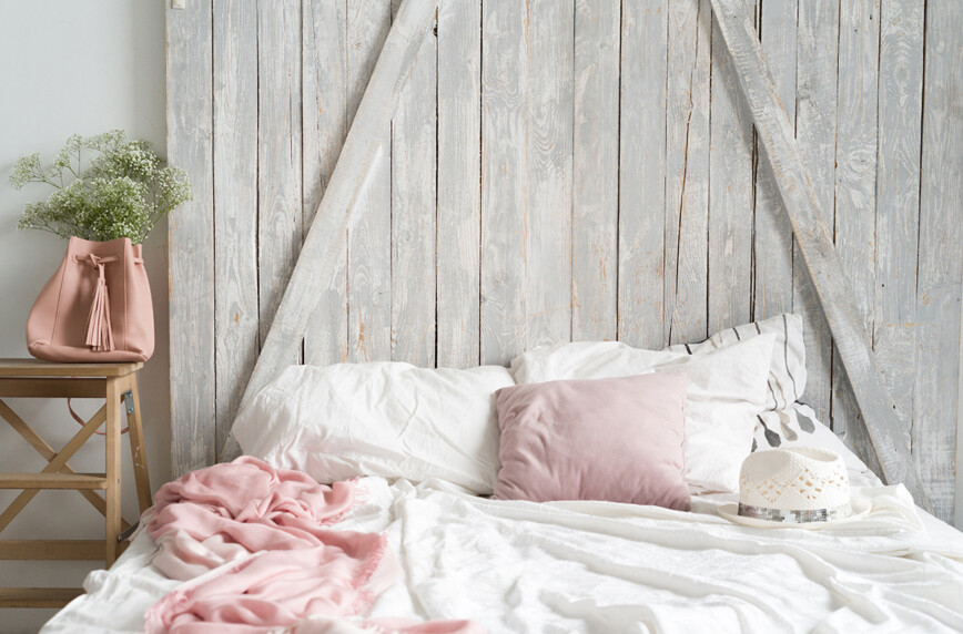 Light airy bedroom. Distressed wiid and pastel colours