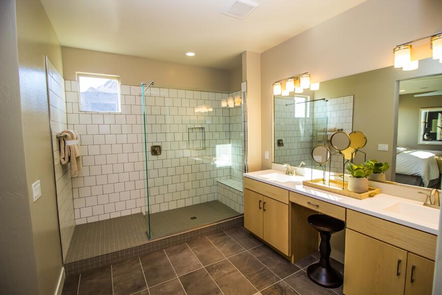 Walk in shower. Bathroom with double sink