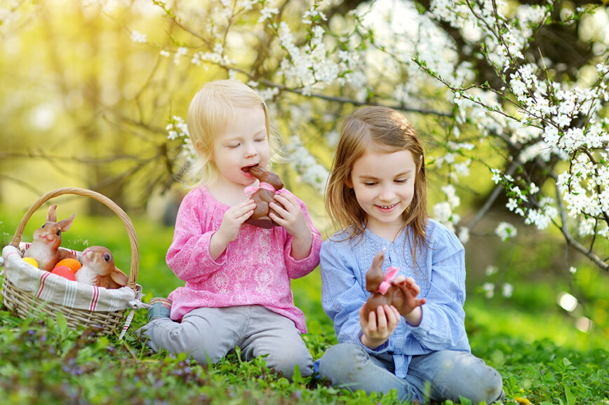 Children eatting chocolate easter bunnies