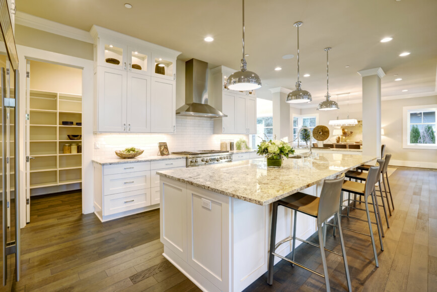 Large White Kitchen With Large Kichen Island.  Plus Walk-In Butlers Pantry