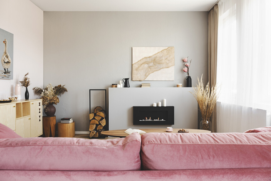 Pink sofa and electric fire