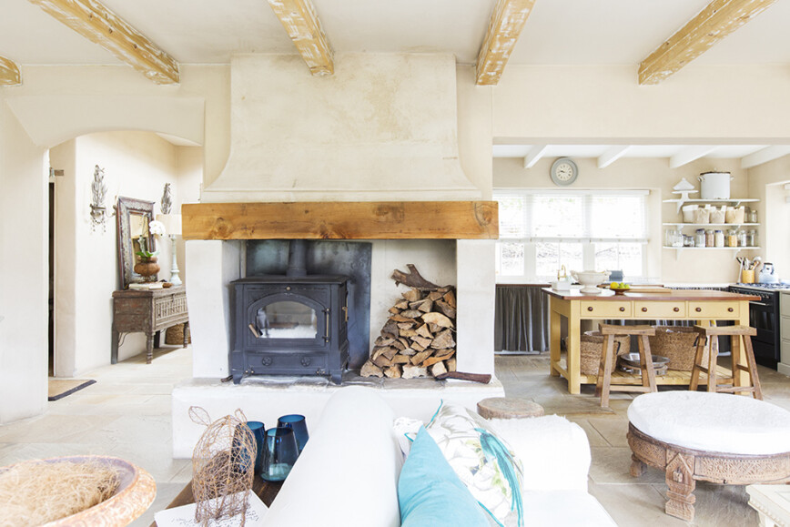 Cottage interior with large fireplace with woodburning stove
